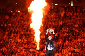 Former New Zealand captain Richie McCaw holds the Rugby World Cup trophy during the tournament's opening ceremony