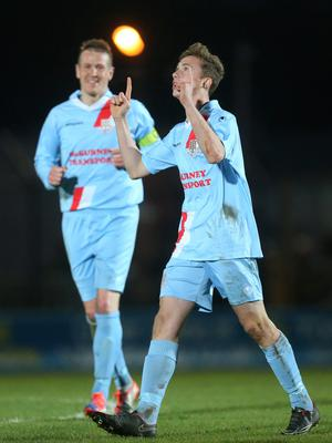 Ballymena's 15-year-old Matthew Shevlin celebrates his goal against Ballinamallard United on Saturday and below, he's mobbed by his team-mates