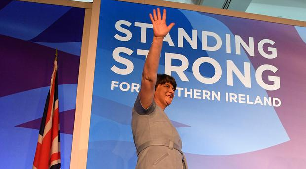 Arlene Foster acknowledges the audience at conference
