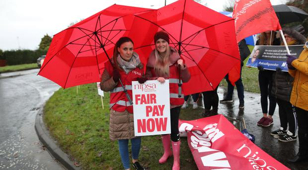 Social workers Kelly McMath and Carrie Wright join the strike outside Craigavon Hospital