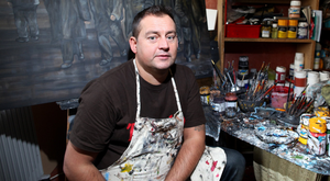 Artist John Stewart in his studio in east Belfast