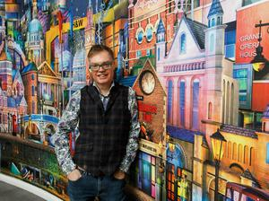 Keith Drury with his unique artwork which has pride of place in the Ramada by Wyndham Belfast