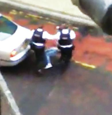 Video footage showing the police moving the incapacitated woman to the bus lane