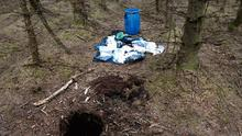 A barrel containing weapons, which were recovered from woodland near Larne in Northern Ireland by police investigating Ciaran Maxwell (PSNI/PA)