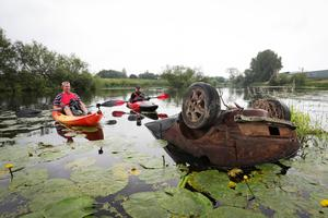 Edwin Poots and Jon Medlow come across a dumped car in River Bann