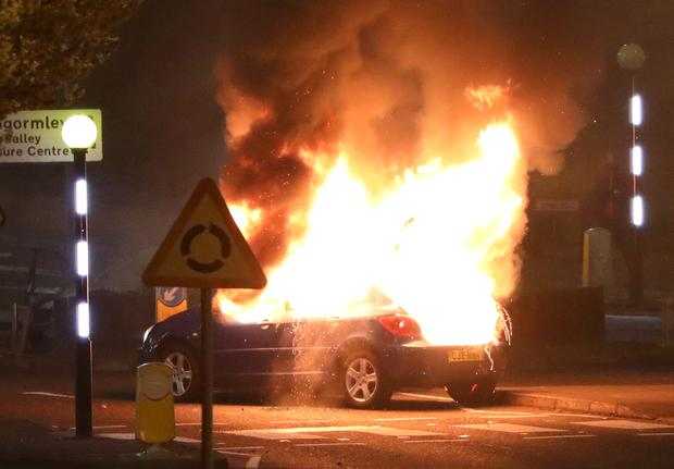 A burning car that was hijacked by loyalists at the Cloughfern roundabout in Newtownabbey on Saturday night (Peter Morrison/PA)