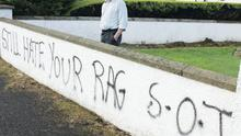 Coleraine mayor, George Duddy, outside his house yesterday after the walls were daubed with graffiti