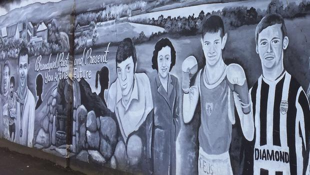 A mural in Brandywell of Ryan McBride (right)