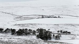 Fresh snow surrounds a lone farmhouse in Teesdale, County Durham.