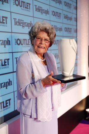 Maud receiving her Telegraph Woman of the Year award