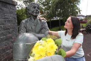 Joey Dunlop's youngest daughter Joanne places flowers on his statue in Ballymoney