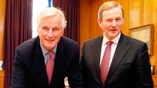 Taoiseach Enda Kenny invites Michel Barnier to sign a visitors' book yesterday