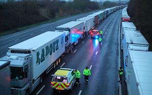 Backlog: Lorry drivers parked on the M20 in Kent after the Port of Dover was closed