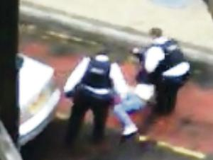 Video footage showing police moving the incapacitated woman to the bus lane