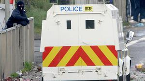 Petrol bombs were thrown at a house on the outskirts of west Belfast