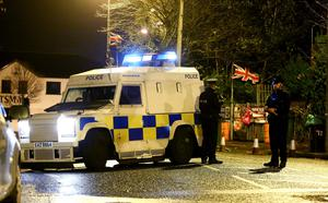 Police at Twaddell on Monday after a device was launched at a PSNI patrol on the Woodvale Road in North Belfast