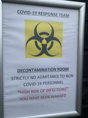 The sign on their decontamination room