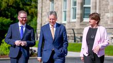 Simon Hamilton, Peter Robinson and Arlene Foster at Stormont Castle yesterday
