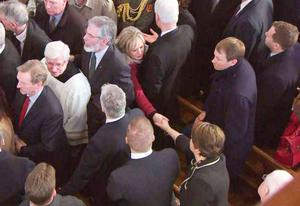 Arlene Foster and Michelle O'Neill shake hands at the late Deputy First Minister's funeral