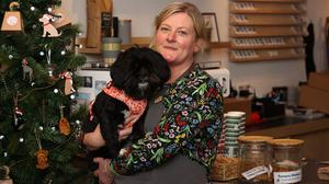 Karen Breene, co-owner of pet store Murphy and Bailey in Belfast with her dog Mollie (Liam McBurney/PA)