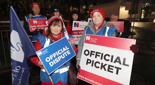Cancer nurses Iona McCormack (left) and Edel Coulter outside Belfast City Hospital during the pay strike (Liam McBurney/PA)