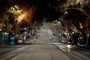 Collins Street in Melbourne city centre is deserted after the 8pm to 5am curfew was introduced