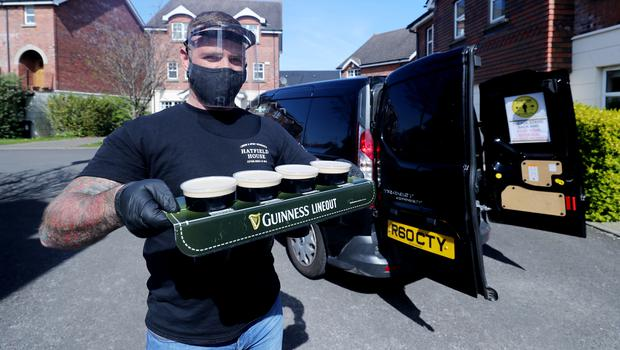 Harry McKeaveney delivers pints of draft Guinness around Belfast (Niall Carson/PA)