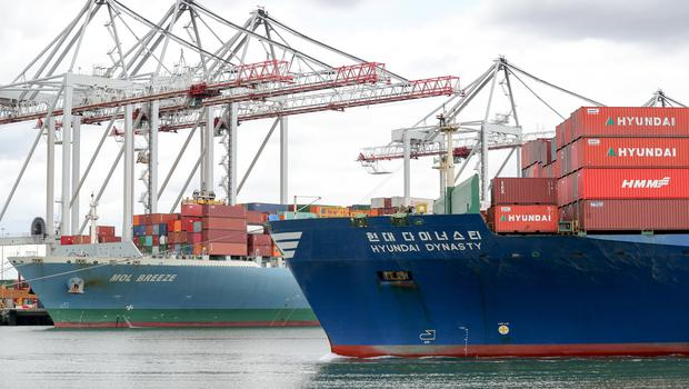 The container ship Hyundai Dynasty (right) passes the container ship MOL Breeze as she makes her way into Southampton Docks (Andrew Matthews/PA)