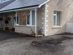 Windows were smashed and a car set alight at the Shimna Road property in Newcastle