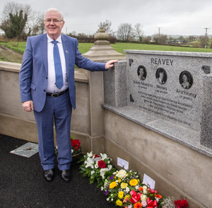 Eugene Reavey at the graves of his brothers
