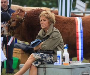 Enjoying the Omagh Show is a lady watching the proceedings