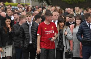 Mourners pay their respects at the funeral