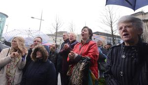 The pastor's supporters celebrate outside court