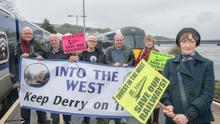 Mary Kerrigan with members of the Into The West lobby group at Translink's railway station in Derry