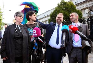 Civil partners Grainne Close (left) and Shannon Sickles with Christopher Patrick Flanagan and Henry Edmond Kane (right) leaving the High Court in Belfast