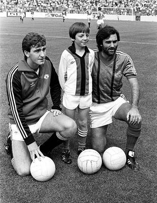 George Best in a Glentoran shirt with another ex Northern Ireland international Norman Whiteside - and a young Stephen Chick