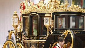 The Queen and Colombia's president Juan Manuel Santos ride in a state carriage