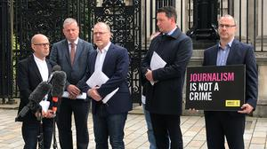 Belfast journalists Barry McCaffrey (left), solicitor Niall Murphy, journalist Trevor Birney, solicitor John Finucane and Patrick Corrigan of Amnesty International outside the Royal Courts of Justice in Belfast (Rebecca Black/PA)