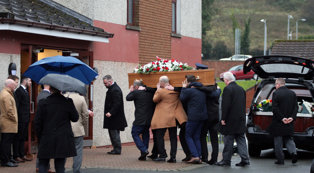 Robert James Walkingshaw's coffin is carried into Grace Baptist Church in east Belfast yesterday