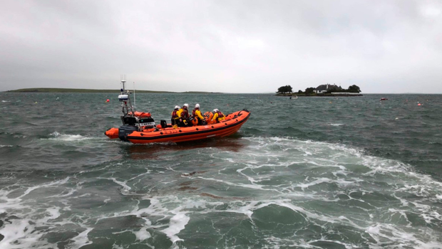 Portaferry RNLI crew speeding to the aid of workers stranded on an island in Strangford Lough