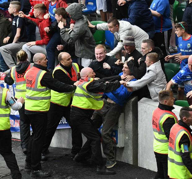 Stewards are forced to act as tempers rise in stands.