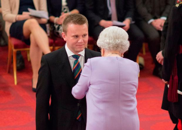 Honour: The Queen presents Thomas Hogg with his MBE in 2016