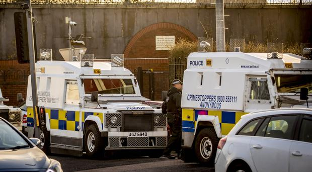 Police officers search a flat in the Divis Tower, west Belfast