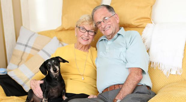 Barry Moore and Josephine Brown, from Newtownabbey, who have just got engaged, with Ollie the dog.