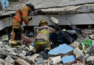 Rescuers dig in the ruins after the earthquake