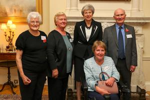 Pat Crossley (left), PM Theresa May and other MS Society members