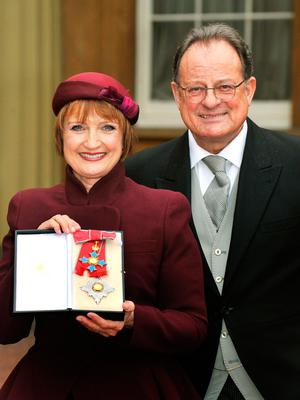 Former Labour cabinet minister Dame Tessa Jowell with her husband David Mills after receiving her Dame Commander of the Order of the British Empire in 2013