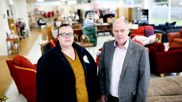 Blythswood Ireland CEO Gary Anderson and shop assistant Paula McCullough inside the charity shop in Antrim
