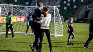 The Duke and Duchess of Cambridge playing football with children during their visit to Windsor Park, Belfast (Liam McBurney/PA)