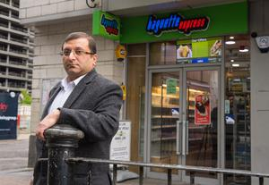 Ihsan Bashir outside his family's business in London's Docklands (Dominic Lipinski/PA)